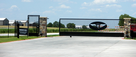 gated airport leads to aircraft hangar homes