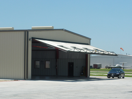 Schweiss Hydraulic Doors provides shade for the fron of the hangar